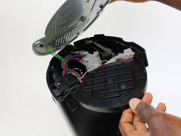 Turn the Keurig over, and unscrew five 25.5 mm Phillip #1 screws, and remove bottom panel.