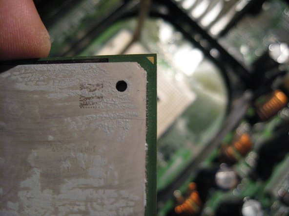 Note , another guide arrow on the topside of the chip.