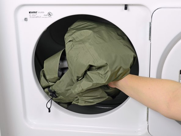 If you don't have a dryer, use an iron on a low setting to heat-set the water repellency treatment.