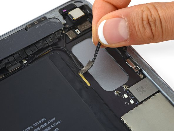 Upon reassembly, it is important to reattach the antenna cables to the motherboard with grounding tape properly adhered on the copper strip underneath.