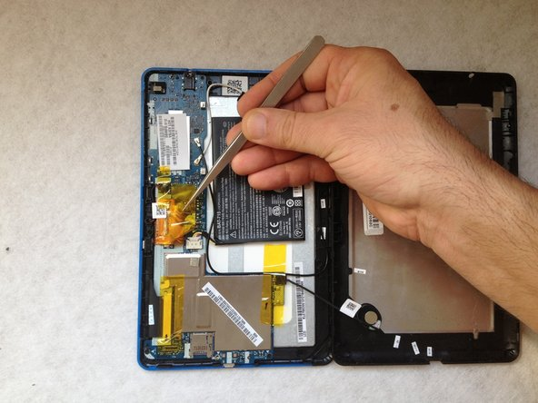 Image 1/3: The battery is stuck to the LCD metal frame with a double side adhesive tape. With a plastic tool carefully separate it .