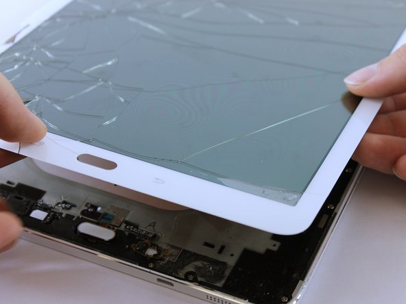 Image 1/2: There is a ribbon cable attached. Lifting the screen too quickly can damage the cable.