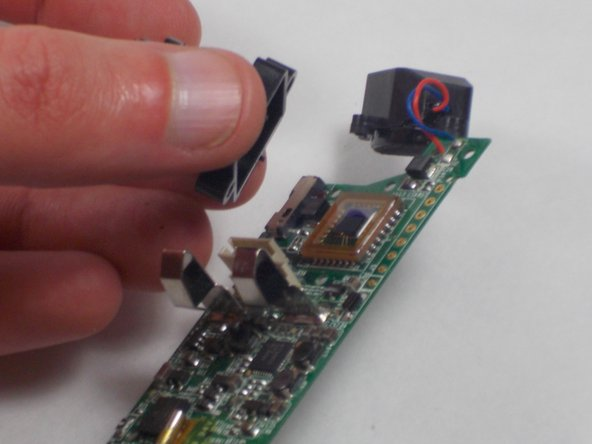 Remove the single 2.1 mm screw and separate camera from the circuit board.