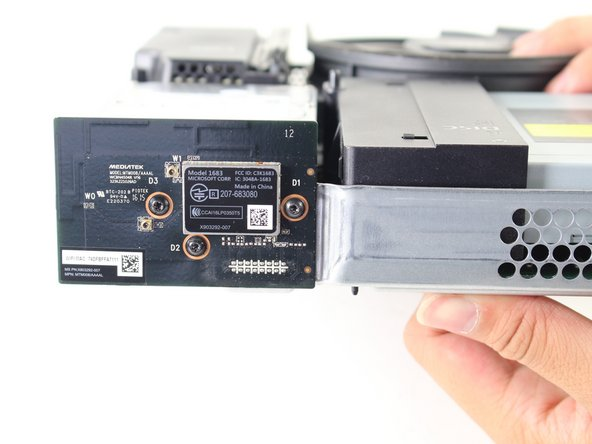 Search the sides of the interior case for the Wi-Fi card. It should be across from the hard drive.
