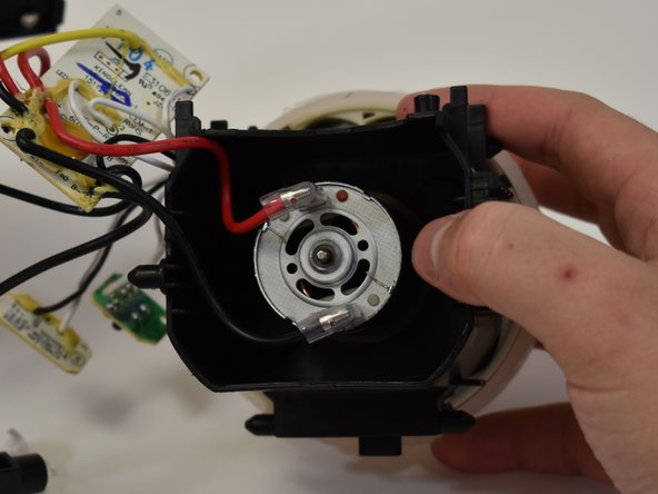 Disconnect the power leads from the vacuum motor.