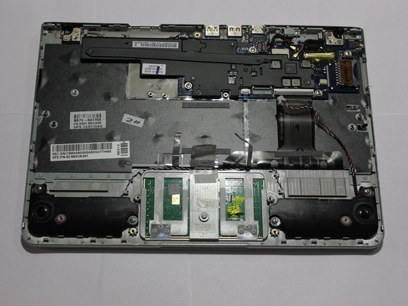 Image 2/2: When reassembling the device, make sure to lay down the metallic tape in the same place it was prior to disassembly. The tape serves as a connector for certain electrical circuits that should not be disconnected.