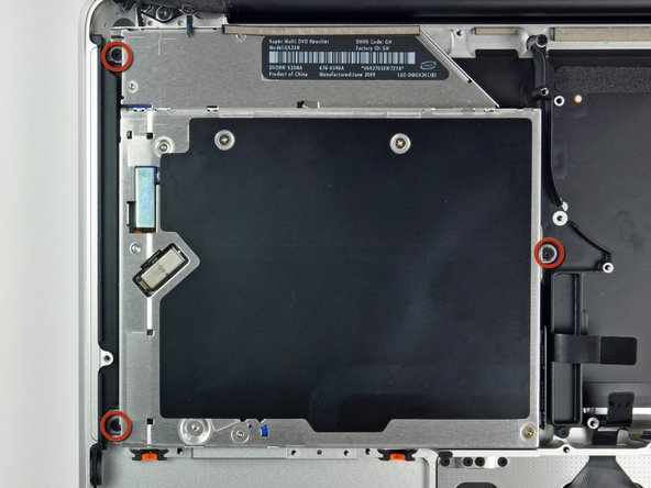 Image 1/2: Lift the optical drive from its right edge and pull it out of the computer.