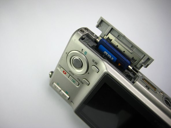 The memory card will automatically rise part way out of its compartment.