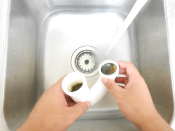 Carefully rinse the P-trap with hot water.