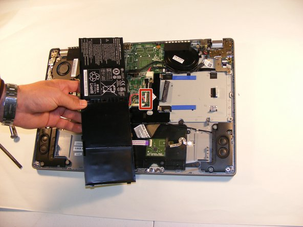 Unplug the marked plug from the motherboard and this will complete the removal of the battery.