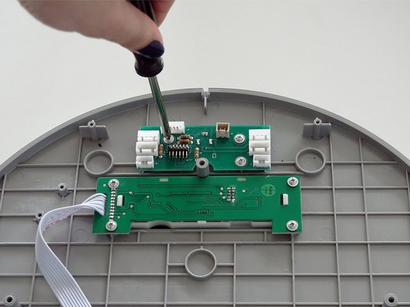 Remove the three screws from the circuit board on bObi Pet's cover.