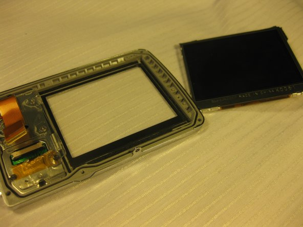 Be careful to not scratch the new LCD screen when replacing it.