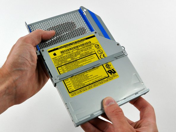 Image 1/1: It may be necessary to wiggle the optical drive as you pull it away from the cage to free it from the vibration isolating material.