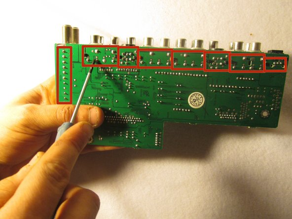 Image 1/1: Each red rectangle contains the electrical components for a specific group of I/O ports