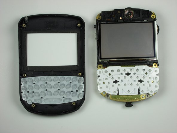Turn the logic board mounting plate over to reveal the LCD display.