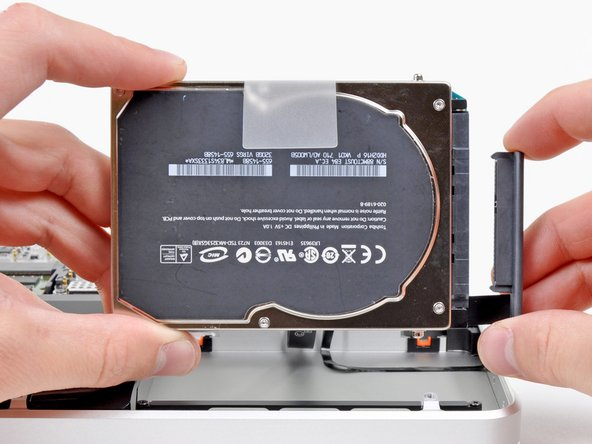 Image 2/2: Remove the hard drive from your MacBook Pro.