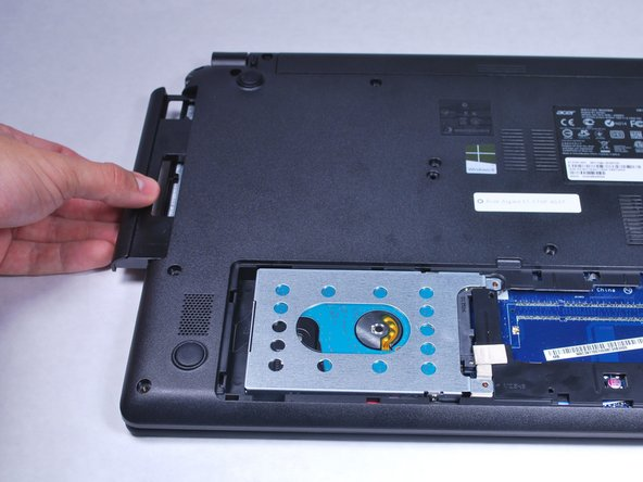 Slide out the disk drive tray.