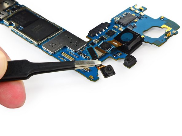 Remove the front-facing camera from the motherboard with a pair of tweezers.