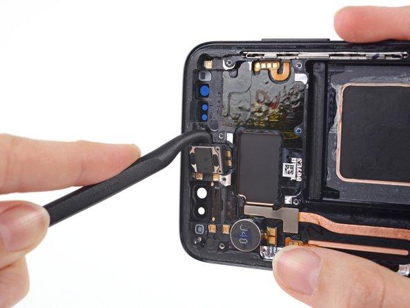 Image 2/3: Remove the earpiece speaker.