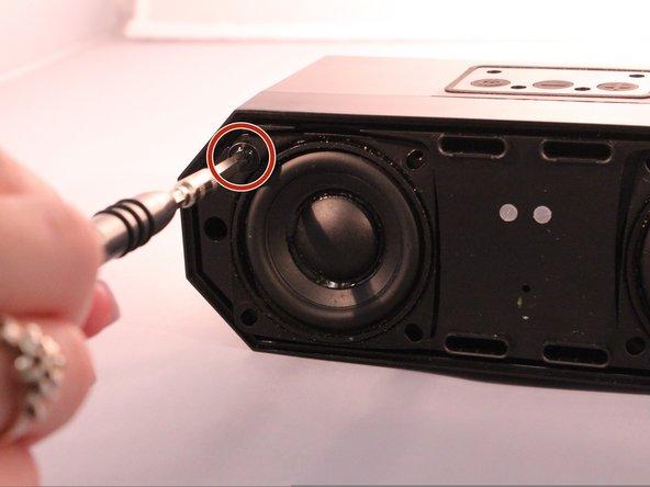 Using the size PH1 screwdriver remove the screws (4 around each speaker).