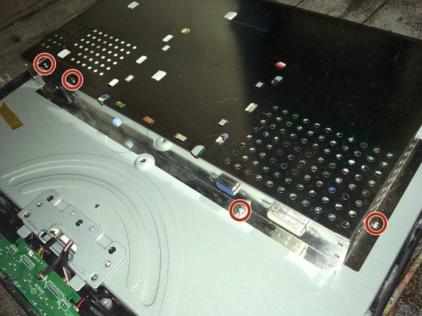 Remove the seven Phillips #1 screws.