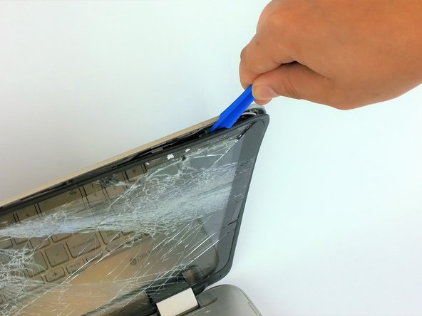 Only after removing the two bottom corner screws in Step 1, separate the screen from the back using an opening tool.