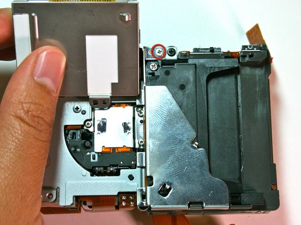 Remove the card-reader shield by removing the screw at the top of the shield.