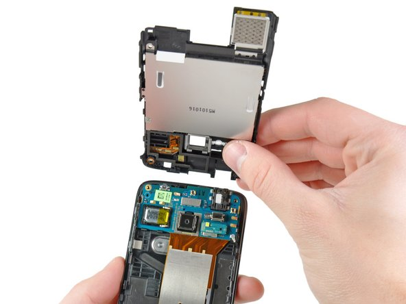 The upper section of the inner case also has a small interconnect board to connect the speaker to the top motherboard in addition to an antenna and integrated shields for EMI protection.