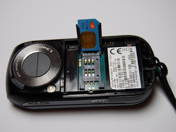 Insert the new SIM card in the orientation shown.