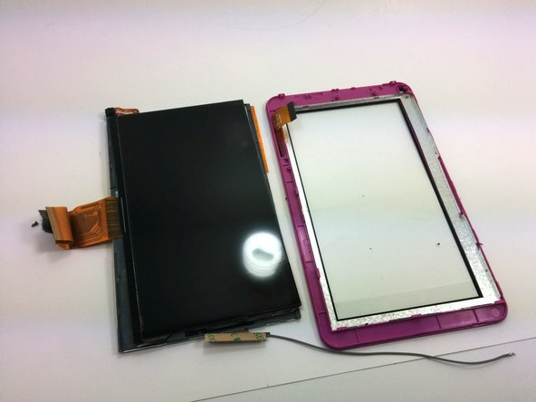 A second spudger may be necessary to help hold the position of the display screen