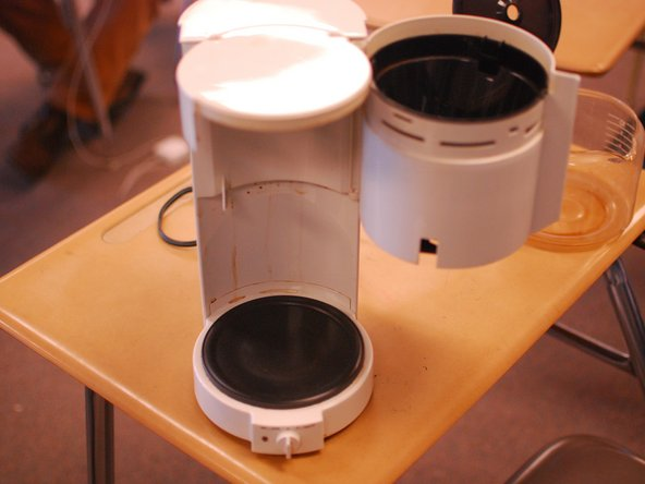 Image 3/3: Finish it up by cleaning the rest of the body of the coffee maker with a damp rag (a very light soapy water mixture might be needed). The warming plate may have the residue of burnt coffee, so use a scrubby rag or [http://amzn.com/B0011DO14G|Scotch-Brite blue scouring pad] to get it clean. Make sure you do not leave any visible residue on your coffee maker.