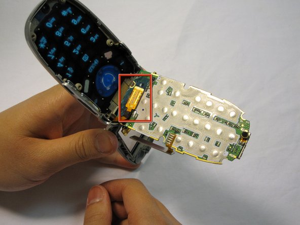 Image 1/3: Pry the connector free from the board with your fingernail.
