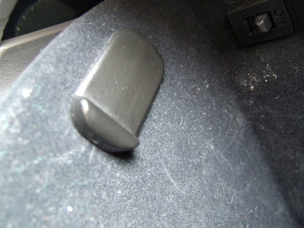 The flanges of the stopper arms should rest flat against the inside wall of the glove box. If they do not rest flat, you have not slid the stops up all the way in the holes.