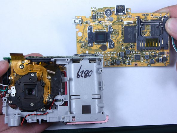 Image 3/3: Continue to remove the board completely.