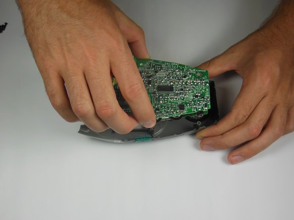 Image 1/3: Pull the circuit board off of the device's plastic casing.