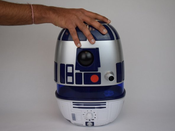 Remove the top cover by pulling upwards on R2's head.