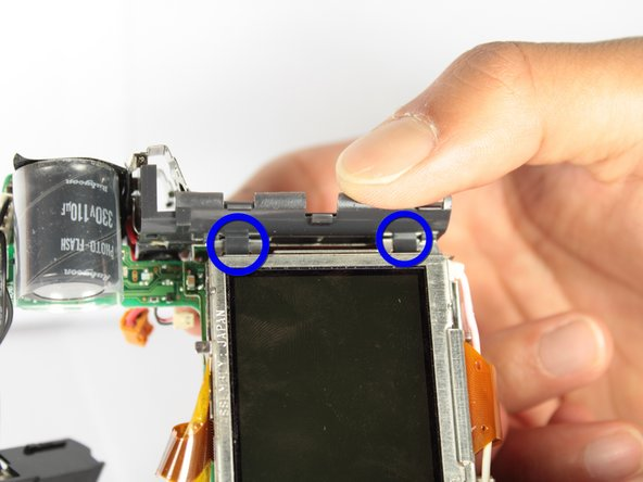 Image 1/3: The battery compartment should now be detached from the rest of the motherboard unit.