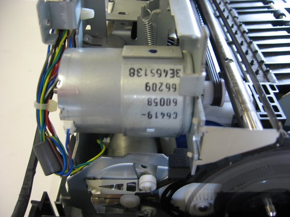 The motor carriage holds (you guessed it) the motor that moves the carriage assembly along and makes your printer print. Should you need to replace your printer's motor, this is your area of focus.