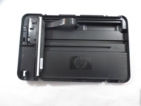 Pull the back panel towards you and lift it away from the rest of the printer cover.