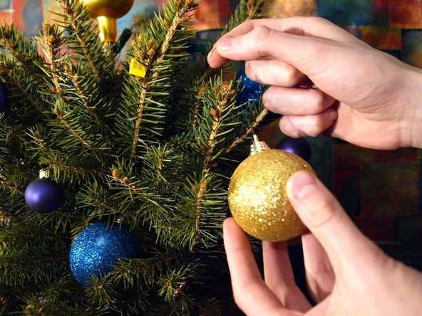 To remove the baubles, lift them gently and untangle the string from the branch.