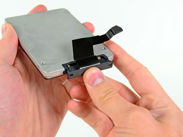Attach the cable included in the kit to your second hard drive. In our case, we are using an SSD.