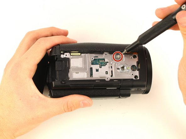 Remove the 3 mm Phillips #00 screw from the bottom of the camera.