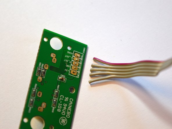 Heat up the contact point on the circuitboard.