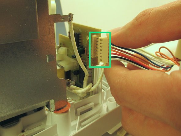 Pull the pin header cable to disconnect the body of the toaster from the main assembly unit.