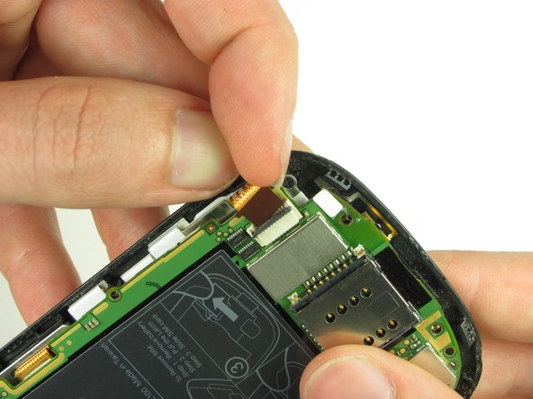 Pull on the ribbon cable gently with your fingers
