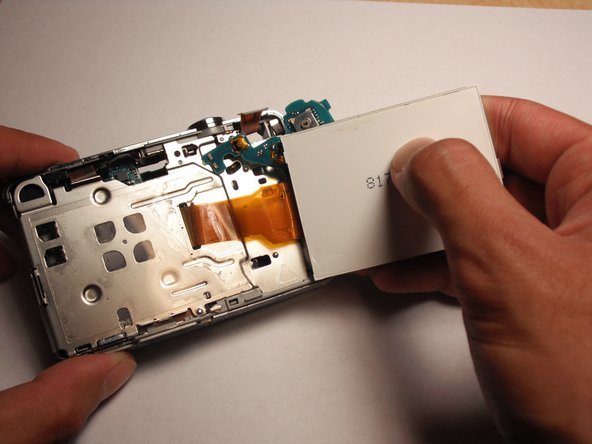 Remove the chip and the LCD screen now from the camera.