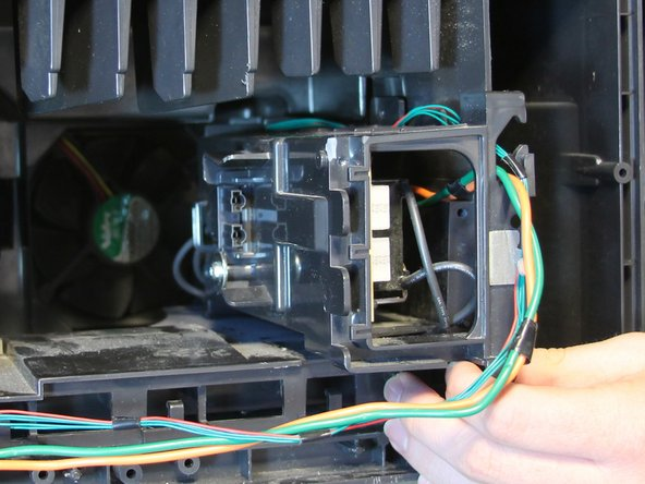 Pull straight back on the lamp ballast housing to remove it from the television.