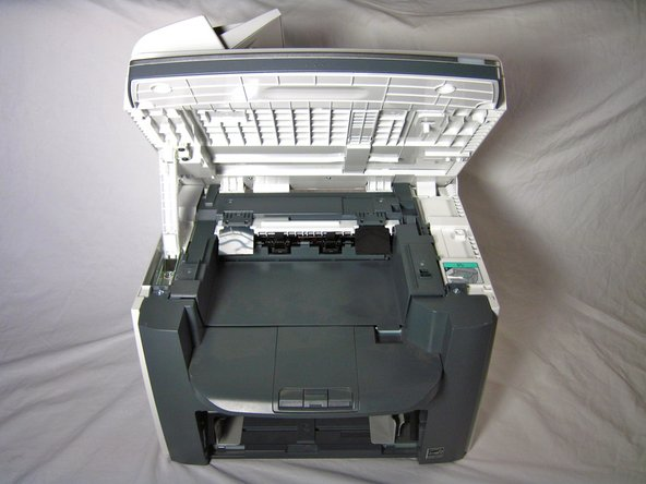 Lift the printer lid up as shown in the photo.