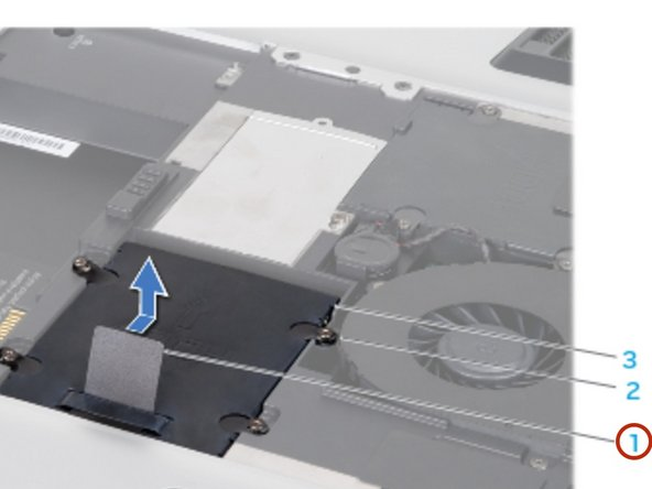 Using the pull tab, slide the primary hard drive (HDD0) towards the back of the hard drive bay and lift it out.