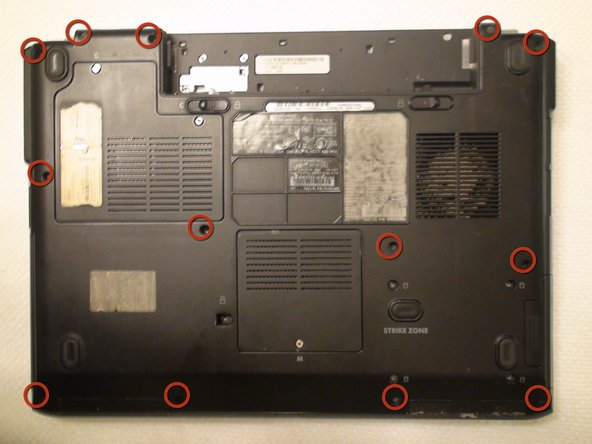 Locate the thirteen 10 mm Phillips #1 screws securing the bottom panel of the laptop.